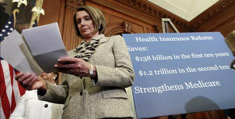 House Speaker Nancy Pelosi, D-Calif., reviews notes at a news conference on health care on Thursday.
