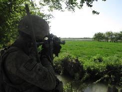 Staff Sgt. Jonathan Hughes scans the western edge of the Arghandab River on Friday, watching for Taliban forces patrolling on the other side.