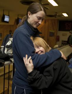 Beth Swiatowiec hugs instructor Cassie Herzog at Irving Park Bowling Lanes.