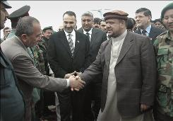 Afghan Vice President Mohammad Qasim Fahim, right, expressed hope Sunday that an upcoming national conference will lay the foundation for peace with insurgents as a dozen civilians died in separate bombings in front-line provinces.