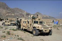 Armored Humvees, in their heyday, were combat troops' workhouses, shown here in Afghanistan's Kapisa province.
