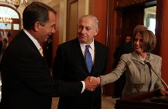 Israeli Prime Minister Benjamin Netanyahu, center, is welcomed by House Speaker Nancy Pelosi and House Minority Leader John Boehner on Tuesday in Washington, DC.