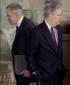 Senate Majority Leader Harry Reid of Nevada, left, walks past Senate Minority Leader Mitch McConnell of Kentucky at the Blair House in Washington on Feb. 25, before the start of a health care reform meeting with President Obama.