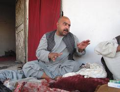 Afghan national police commander Nadir Jan sits outside his checkpoint in Sarkari Bagh.