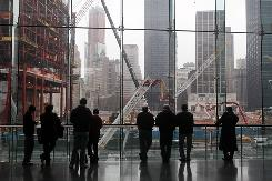 People look out toward the World Trade Center site on March 12 in New York City. An agreement Thursday will allow four office towers to be built in the space.