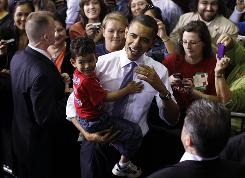 President Obama holds four-year-old Barack Anthony Stroud after he spoke about health care reform on Thursday, March 25,  at the University of Iowa.
