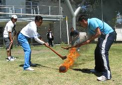 Players go after a flaming ball with oak sticks during a game of <i>pelota purepecha</i> in Mexico City. <i>Pelota purepecha</i> is one of about 150 pre-Hispanic games that are on the verge of dying out.