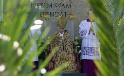 Framed by palm tree branches, Pope Benedict XVI celebrates an open-air Palm Sunday mass in St. Peter's square at the Vatican. Palm Sunday opens Holy Week, the church's most solemn week.
