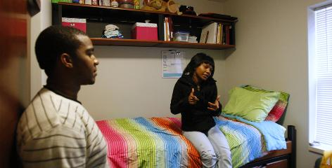 Brionna Brown, right, chats with Tracy Steagall at the University of Cincinnati's &quot;Gen-1&quot; house on campus in November. Gen-1 is for students that are the first generation of a family to attend college, providing support for students who are historically at high risk to drop out.