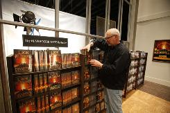 Film director Mitch Brisker arranges books on a film set at The Church of Scientology's Golden Era Productions facility in San Jacinto, Calif. The complex is the main video and multimedia production facility and home to about 400 so-called Sea Organization members.