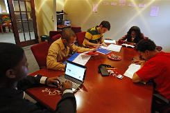 From left, Demarcus Jones, Isa Shakir, Josh Giles, Ndeye Ba and LaRue North work in the study room at their Gen-1 house on the University of Cincinnati campus.
