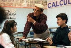 Jaime Escalante, center, teaching math at Garfield High School, in Los Angeles. Escalante is the teacher on which the character in the 1988 movie Stand and Deliver is based. Escalante died Tuesday at age 79.