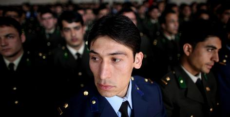 An officer looks on during a speech March 18 by Afghan President Hamid Karzai at Afghan National Army Academy in Kabul.