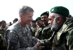 "U.S. Army Gen. Stanley McChrystal, above, inspects an Afghan National Army guard of honor March 25 in Herat. Good leaders are ""more important than equipment...more important than doctrine,"" McChrystal says."