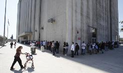 People line up March 18 outside the Metropolitan Courthouse in L.A.