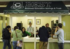 Students check out BEST bank during its opening Feb. 16 at Carter High School in Strawberry Plains, Tenn. The school partnered with First Century Bank.