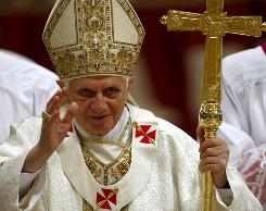 Pope Benedict XVI arrives in St. Peter's Basilica to celebrate a Chrism Mass at the Vatican on Thursday.