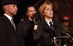 District of Columbia Mayor Adrian Fenty, left, Assistant Police Chief Peter Newsham, and Police Chief Cathy Lanier speak about the shooting of 10 people, of whom five died, At right is William Cheek, grandfather of one of the victims.