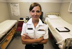 Lt. Cmdr. Rendi Murphree Bacon, a quarantine public health officer with the U.S. Centers for Disease Control, poses inside the isolation room at Chicago's O'Hare International Airport.