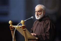 Rev. Raniero Cantalamessa delivers the Good Friday homily during a service celebrated by Pope Benedict XVI  in St. Peter's Basilica at the Vatican, Friday.