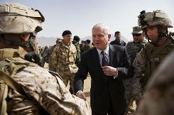 Defense Secretary Robert Gates meets servicemembers March 10 on a tour of Camp Blackhorse near Kabul.