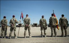 German ISAF soldiers attend a military farewell ceremony for three killed comrades at the German ISAF base in Kunduz, Afghanistan, Sunday. Three German ISAF soldiers have been killed during a fight with Taliban fighters, eight soldiers were wounded.