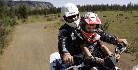 Rob Huntington and his son Colton, 6, from Crabtree, Ore., ride their ATV past Hayrick Butte in the new Santiam All-Terrain Vehicle area near Santiam Pass, Ore., on July 24.