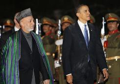 President Obama reviews the honor guard with Afghan President Hamid Karzai at the presidential palace in Kabul, Afghanistan, March 28.
