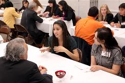University of Texas at El Paso Biological Sciences sophomore Sharon Gonzalez listens in as freshman Reina Hernandez questions Dr. David Palafox, Medical Director for El Paso First Health Plan, at a speed mentoring event.