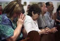 Attendees at a prayer service Tuesday at St. Joseph Catholic Church in Whitesville, W.Va., a day after the blast at the nearby Massey Energy mine.