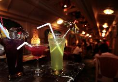 Cocktails ready to be served. People whose friends or relatives drank heavily were 50% more likely to also drink heavily, according to a study.