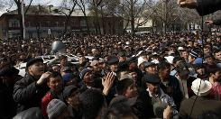 Kyrgyz protesters listen to opposition lawmaker Isa Omurkulov, not pictured, as they gather in front of Kyrgyz government headquarters on the central square in Bishkek, Kyrgyzstan, on Thursday. 