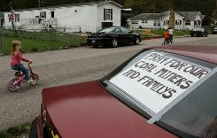 "A sign that reads ""Pray For Our Miners And Families"" is taped to the back window of a car on April 8, in Whitesville, West Virginia."