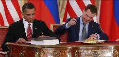 President Obama and Russian President Dmitry Medvedev sign the new START treaty on Thursday at the Prague Castle.