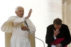 Pope Benedict XVI, flanked by personal secretary Georg Gaenswein, delivers his blessing during the weekly general audience in St. Peter's Square, at the Vatican, April 7.