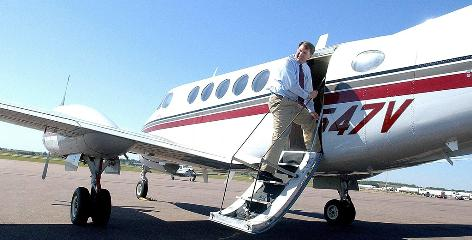 South Dakota Gov. Mike Rounds, shown boarding a state plane in 2005, later had his flights blocked from tracking websites.