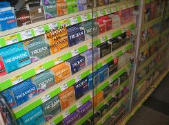 Shelves of condoms for sale at a CVS store. Teens are better about using condoms than older adults, a large new survey shows.
