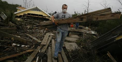 James Burns of Concord, N.C., a volunteer from Elon University, removes debris from a home. He is one of more than 55,000 volunteers who have worked with Lutheran Episcopal Services.