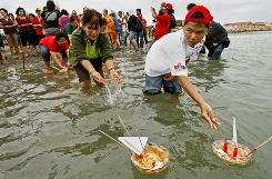 Buddhist adherents release about 300 offerings into the sea at Banda Aceh, Indonesia, after a prayer on Dec. 20 to remember the victims of the tsunami in 2004.