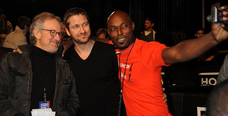 Gerard Butler, center, with Steven Spielberg, left, and Jimmy Jean-Louis at the Hope for Haiti Now benefit on Jan. 22.