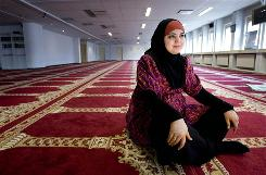 Yassmine el Ksaihi poses in the prayer hall of the Polder Mosque in Amsterdam, Netherlands.