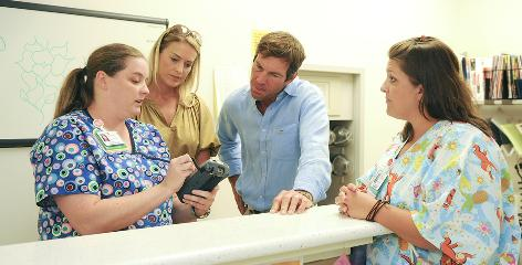 Actor Dennis Quaid and his wife Kimberly Buffington listen to staff at the Children's Medical Center Dallas as they toured the hospital to learn about systems to prevent medical errors.