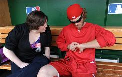 Erin Turner and Philadelphia Phillie Jayson Werth compare notes on their wrist surgeries.