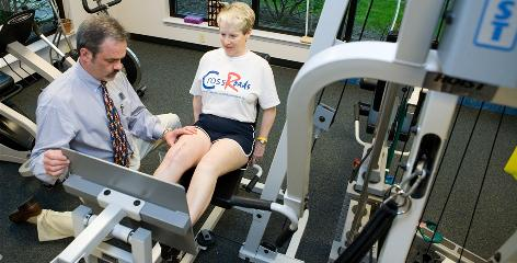 """Dolores """"Jeanne"""" Streightiff, right, of Hollidaysburg, Pa., works with physical therapist Tim Parnell after her second knee surgery. She has osteoarthritis."""