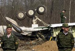 Russian Interior Ministry soldiers secure the crash site Tuesday where the Polish presidential plane crashed Saturday just outside the Smolensk airport in western Russia.