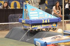 Students from Wissahickon High School in Ambler, Pa., watch their Robot Miss Daisy take the bump at a regional competition in New York before they headed to the FIRST championships in Atlanta.