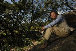 "Eckhart Tolle sits in the woods behind his home in Montecito, Calif. Tolle teaches people to let go of anything in their own minds that blocks their ability to see the ""the Now,"" or ""Being,"" or ""Presence"" and become one with that which is beyond life and death."