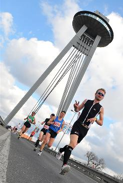 Runners compete during the Bratislava International Marathon on March 28. It's better to stretch after a run (or other exercise) rather than before, experts say.
