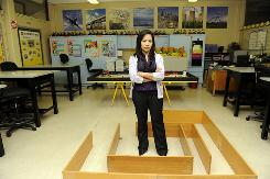 "Ingrid Cruz teaches robotics at Scotlandville Middle Pre-Engineering Academy in Baton Rouge, La., in 2009. She's one of more than 350 teachers that unions allege were kept in ""virtual servitude"" by the recruiting firm that placed them."