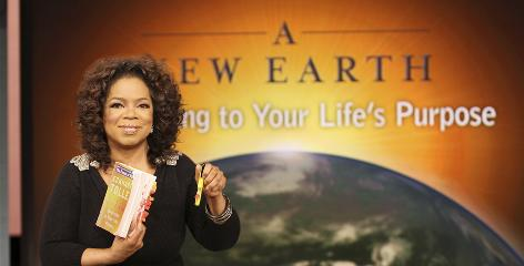 "Oprah Winfrey introduces Eckhart Tolle's ""A New Earth,"" one of her 2008 book club selections, during a taping of her show in Chicago."